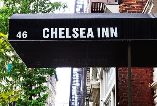 Purple awning of entrance to Chelsea Inn